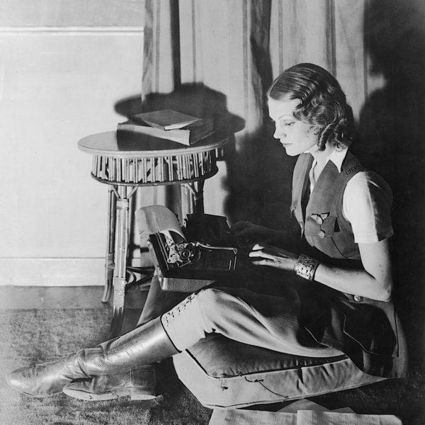 Aloha Wanderwell typing on Remington