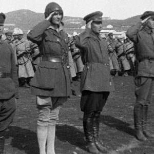 Aloha Wanderwell with Soldiers Saluting